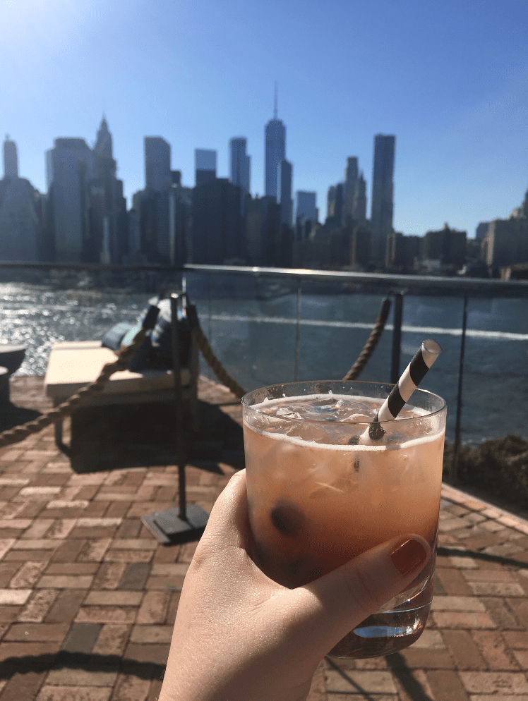 """Kelly Meehan Brown enjoys a drink on a rooftop bar (""""Independent Contractor Taxes, Rooftop Bars, and the True Meaning of Broke"""")"""